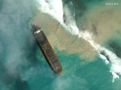 "In this satellite image provided by 2020 Maxar Technologies on Friday, Aug. 7, 2020, an aerial view of the MV Wakashio, a bulk carrier ship that recently ran aground off the southeast coast of Mauritius. The prime minister of Mauritius says the government is appealing to France for help with a brewing environmental disaster after a ship that ran aground almost two weeks ago off the Indian Ocean island nation began leaking oil. Prime Minister Pravind Jugnauth said Friday that the leak ""represents a danger for Mauritius"" and that his country doesn't have the skills and expertise to refloat stranded ships. ( 2020 Maxar Technologies. via AP)"