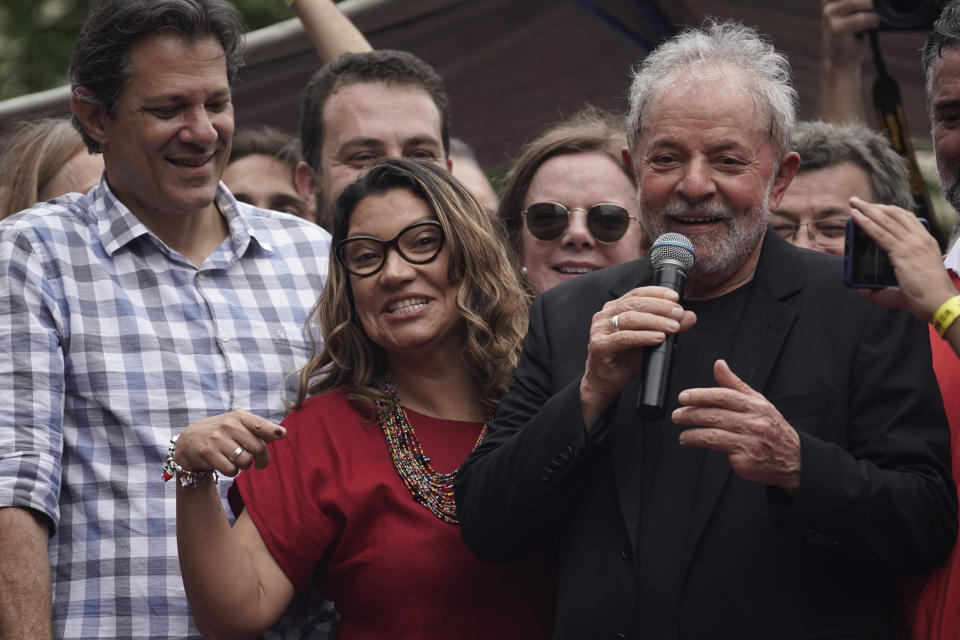 """Former Brazilian President Luiz Inacio Lula da Silva, accompanied by his girlfriend Rosangela da Silva, speaks during a rally at the Metal Workers Union headquarters, in Sao Bernardo, Brazil, Saturday, Nov. 9, 2019. Da Silva addressed thousands of jubilant supporters a day after being released from prison. """"During 580 days, I prepared myself spiritually, prepared myself to not have hatred, to not have thirst for revenge,"""" the former president said. (AP Photo/Leo Correa)"""