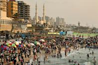 Palestinians gather at the beach in Gaza City on May 28, a week after a ceasefire brought an end to 11 days of hostilities between Israel and Hamas