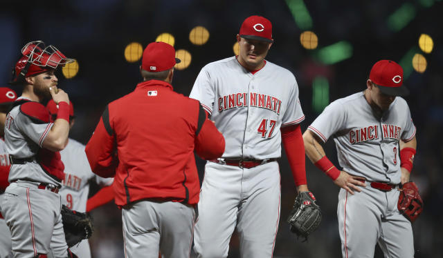 Cincinnati Reds pitcher Sal Romano (47) is relieved by interim manager Jim Riggleman in the third inning of a baseball game against the San Francisco Giants Monday, May 14, 2018, in San Francisco. (AP Photo/Ben Margot)