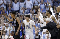 North Carolina coach Roy Williams reaches for Cameron Johnson (13) following Johnson's basket against Duke while Duke's Javin DeLaurier (12) looks back during the second half of an NCAA college basketball game in Chapel Hill, N.C., Saturday, March 9, 2019. North Carolina won 79-70. (AP Photo/Gerry Broome)