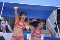 Sarah Pavan, right, of Canada, and teammate Melissa Humana-Paredes celebrate after winning a women's beach volleyball match against Spain at the 2020 Summer Olympics, Monday, Aug. 2, 2021, in Tokyo, Japan. (AP Photo/Petros Giannakouris)