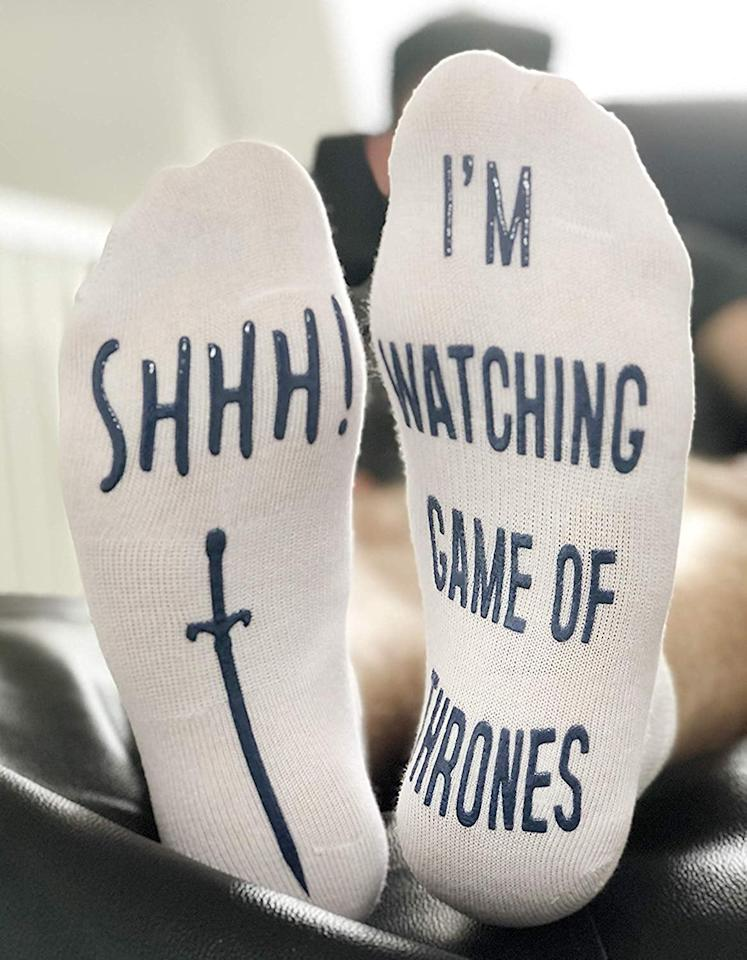 "<p>These <a href=""https://www.popsugar.com/buy/Shhh%20I%27m%20Watching%20Game%20Of%20Thrones%22%20Funny%20Socks-432658?p_name=Shhh%20I%27m%20Watching%20Game%20Of%20Thrones%22%20Funny%20Socks&retailer=amazon.com&price=11&evar1=buzz%3Aus&evar9=43852792&evar98=https%3A%2F%2Fwww.popsugar.com%2Fentertainment%2Fphoto-gallery%2F43852792%2Fimage%2F46010529%2FShhh-Im-Watching-Game-Thrones-Funny-Socks&list1=shopping%2Cgifts%2Choliday%2Cgift%20guide%2Cgame%20of%20thrones&prop13=mobile&pdata=1"" rel=""nofollow"" data-shoppable-link=""1"" target=""_blank"">Shhh I'm Watching Game Of Thrones"" Funny Socks</a> ($11) are awesome.</p>"