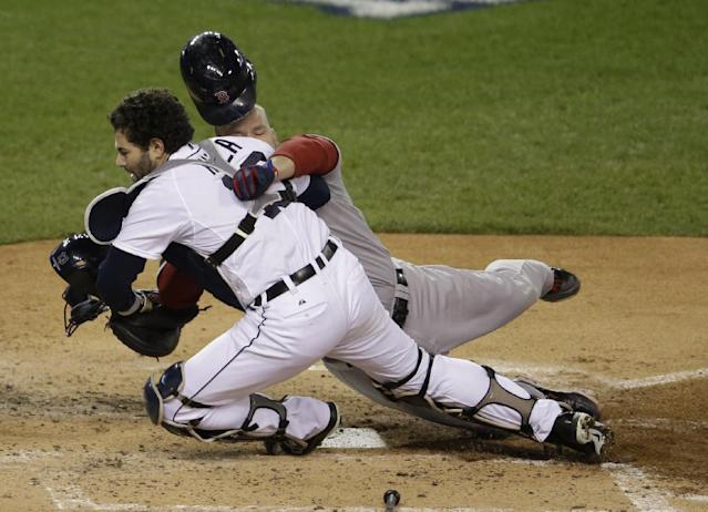 Boston Red Sox's David Ross is out at home on a fielder choice as he collides with Detroit Tigers catcher Alex Avila in the second inning during Game 5 of the American League baseball championship series Thursday, Oct. 17, 2013, in Detroit. (AP Photo/Carlos Osorio)