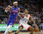 Toronto Raptors guard Kyle Lowry (7) drives against Detroit Pistons guard Bruce Brown (6) during the second half of an NBA basketball game Wednesday, Dec. 18, 2019, in Detroit. The Raptors won 112-99. (AP Photo/Duane Burleson)