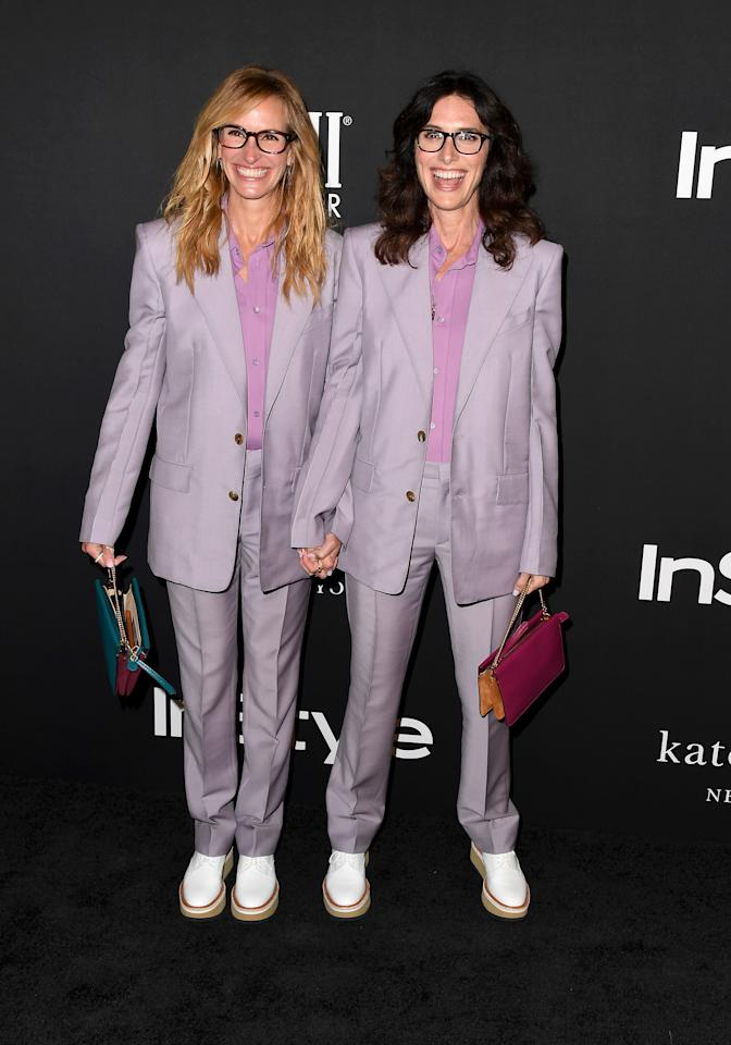 <p>The Hollywood actress and her stylist rocked up at the awards wearing matching lavender trouser suits – and shoes. <em>[Photo: Getty]</em> </p>