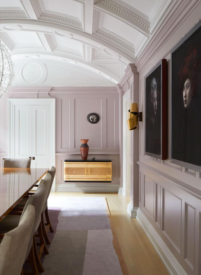 """Newman chose to paint these dining room wall panels a dusty mauve: """"It was a color popular at the end of the 19th century."""" Another notable addition was the floating wall cabinets, which are historical and modern at once."""