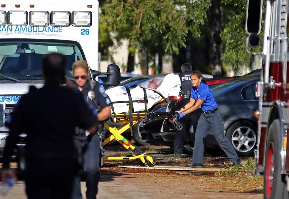 A file photo shows a woman being transported from The Rehabilitation Center at Hollywood Hills as patients were evacuated after a loss of air conditioning due to Hurricane Irma on Wednesday, Sept. 13, 2017, in Hollywood.