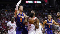 Houston Rockets' James Harden (13) goes up for a shot as Phoenix Suns' Frank Kaminsky (8) defends during the first half of an NBA basketball game Saturday, Dec. 7, 2019, in Houston. (AP Photo/David J. Phillip)