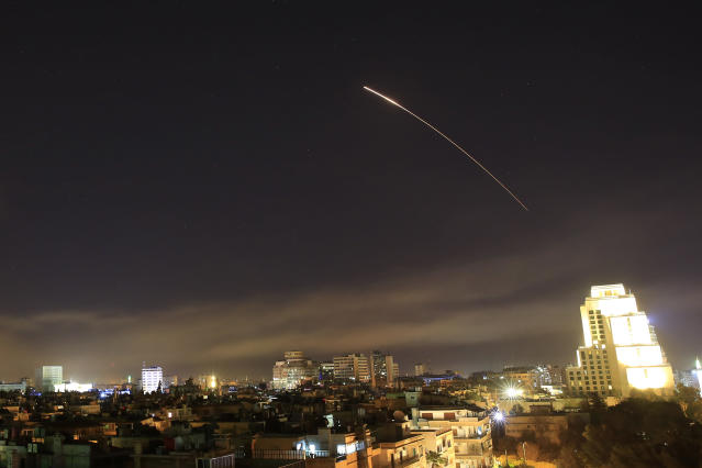 <p>Damascus skies erupt with missile fire as the U.S. launches an attack on Syria targeting different parts of the capital Syria, early Saturday, April 14, 2018. (Photo: Hassan Ammar/AP) </p>