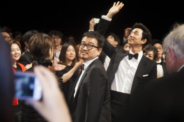 Director Sang-ho Yeon, actor Gong Yoo and guests attend the 'Train To Busan' premiere during the 69th annual Cannes Film Festival. (Photo by Laurent KOFFEL/Gamma-Rapho via Getty Images)