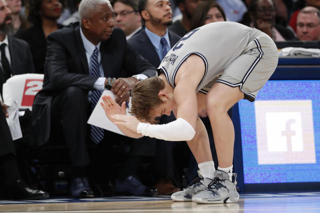 Georgetown guard Mac McClung slaps the floor after being called for a foul during the first half of the team's NCAA college basketball game against Duke in the 2K Empire Classic, Friday, Nov. 22, 2019 in New York. (AP Photo/Kathy Willens)