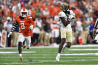 Wake Forest wide receiver A.T. Perry, right, catches a pass for a touchdown in front of Syracuse defensive back Garrett Williams during the second half of an NCAA college football game in Syracuse, N.Y., Saturday, Oct. 9, 2021. (AP Photo/Adrian Kraus)