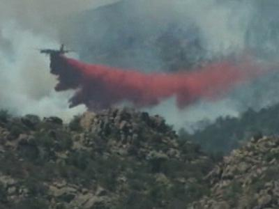 Firefighters continued to battle a wildfire Monday in northern Arizona that has forced residents from their homes in the historic mining town of Crown King just weeks ahead of the busy tourist season. (May 15)