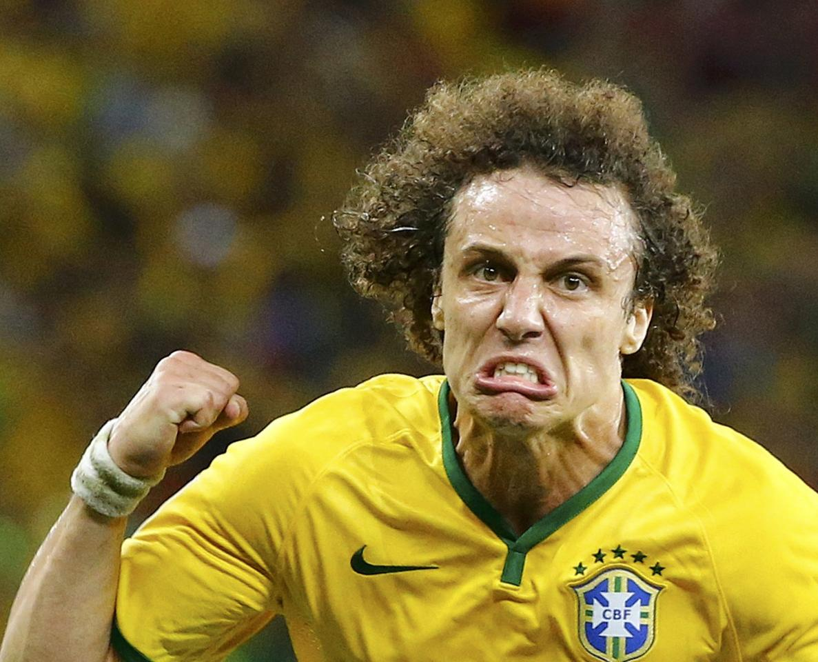 Brazil's David Luiz celebrates after scoring a goal against Colombia during the 2014 World Cup quarter-finals soccer match at the Castelao arena in Fortaleza July 4, 2014. REUTERS/Stefano Rellandini (BRAZIL - Tags: SOCCER SPORT WORLD CUP) TOPCUP