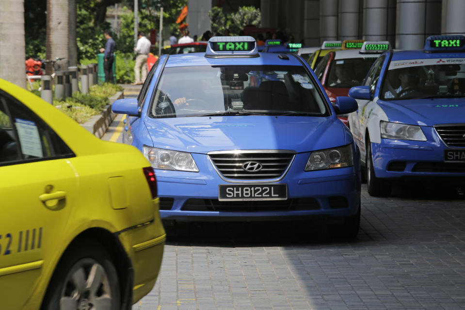 ComfortDelGro taxis wait in front of an office building on 17 May, 2016, in Singapore. (AP file photo)