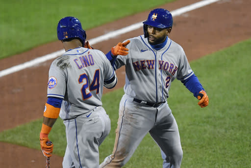 New York Mets' Dominic Smith, right, celebrates with Robinson Can after hitting a grand slam against the Toronto Blue Jays during the fourth inning of a baseball game in Buffalo, N.Y., Friday, Sept. 11, 2020. (AP Photo/Adrian Kraus)