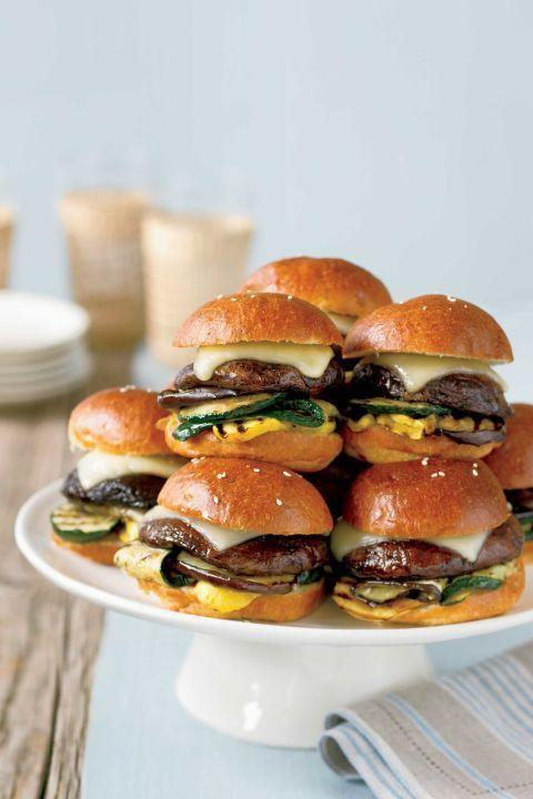"Grilled mini portobello burgers offer vegetarians a savory option for the main course. But you might want to make extra — they look so good that meat lovers might snag one, too! <a href=""https://www.countryliving.com/food-drinks/recipes/a1957/mini-portobello-burgers-clv0707/"" rel=""nofollow noopener"" target=""_blank"" data-ylk=""slk:Get the recipe."" class=""link rapid-noclick-resp""><strong>Get the recipe.</strong></a>"