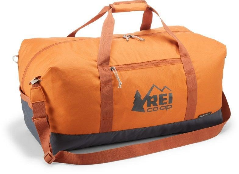 """<h2>REI Co-op Roadtripper Duffel<br></h2><br><strong>The Type:</strong> Packable Duffel<br><br><strong>The Hype: </strong>4.6 out of 5 stars and 87 reviews at REI<br><br><strong>What They're Saying: </strong>""""I truly cannot express how much I love this bag. I am a college student and this bag travels with me everywhere I go. It's amazing. The square design makes it super easy to pack in yet it's still easy to squish into weird spaces in your car since it's not a hard-sided suitcase. Literally, anywhere I travel this is my go-to bag.<br><br>It's super easy to refold back into the pocket, there's plenty of room to fit all the material back in. I think I must have a limited edition pattern but it's really cool looking and the material is pretty tough. It's been camping and traveled in the truck bed and stood up very well.<br><br>Downside: no, it is not waterproof. But there are many other similar options on the market that are waterproof for much more money, and I think this is a great product for the price. Also sometimes the removable shoulder strap comes off when you're not expecting it, so perhaps switching the open hooks on the shoulder strap with something like a carabiner closure would make it superb."""" — Sydney, REI reviewer<br><br><em>Shop <strong>REI</strong></em><br><br><strong>REI Co-op</strong> Roadtripper Duffel (60L), $, available at <a href=""""https://go.skimresources.com/?id=30283X879131&url=https%3A%2F%2Fwww.rei.com%2Fproduct%2F124505%2Frei-co-op-roadtripper-duffel-60l%3Fcolor%3DMAPLE%2520ORANGE"""" rel=""""nofollow noopener"""" target=""""_blank"""" data-ylk=""""slk:REI"""" class=""""link rapid-noclick-resp"""">REI</a>"""