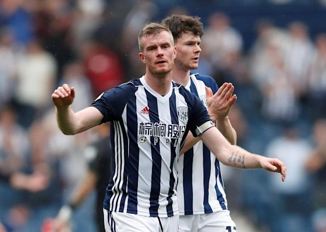 """Soccer Football - Premier League - West Bromwich Albion v Liverpool - The Hawthorns, West Bromwich, Britain - April 21, 2018 West Bromwich Albion's Chris Brunt and Oliver Burke look dejected after the match Action Images via Reuters/Andrew Boyers EDITORIAL USE ONLY. No use with unauthorized audio, video, data, fixture lists, club/league logos or """"live"""" services. Online in-match use limited to 75 images, no video emulation. No use in betting, games or single club/league/player publications. Please contact your account representative for further details."""