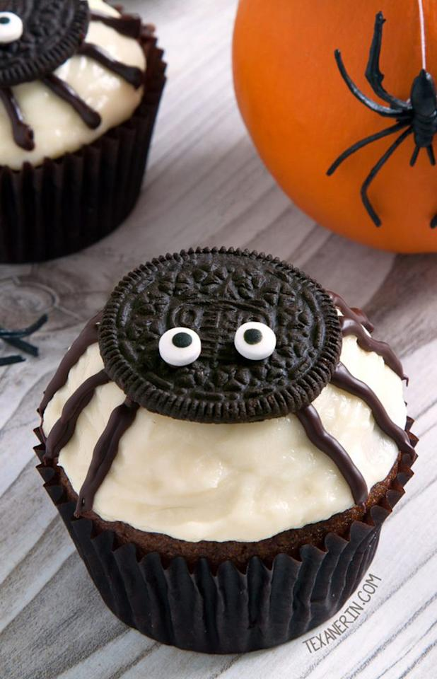 """<p>Top any ordinary cupcake with an Oreo, candy eyes, and chocolate piping legs to create <a rel=""""nofollow"""" href=""""https://www.texanerin.com/spider-cupcakes-for-halloween/"""">these fun spider cupcakes</a>. Mix up the flavors of cake and frosting, and add food coloring to make them whatever spooky hue you want!</p>"""