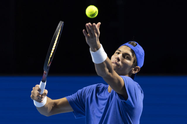 Australia's Alexei Popyrin serves a ball to Italy's Fabio Fognini during their first round match at the Swiss Indoors tennis tournament at the St. Jakobshalle in Basel, Switzerland, on Tuesday, Oct. 22, 2019. (Georgios Kefalas/Keystone via AP)