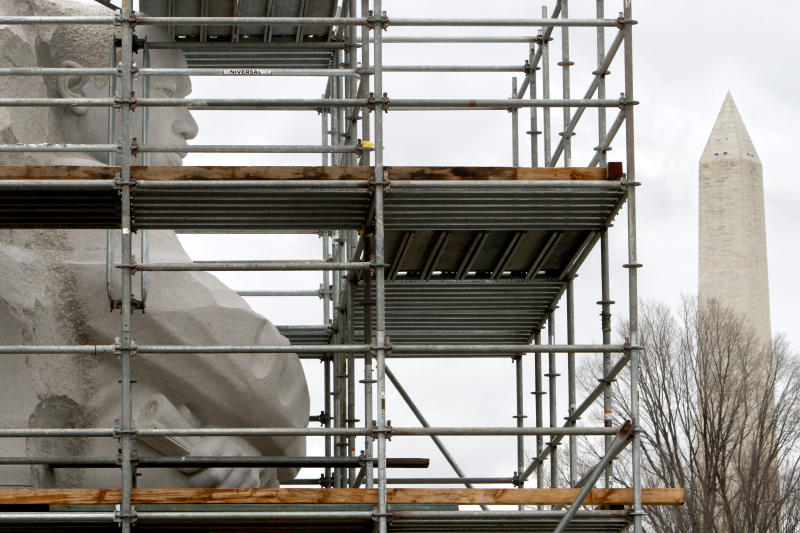 With the Washington Monument in the background, a sculpture of Martin Luther King Jr. is surrounded by scaffolding during a media tour of the Martin Luther King Jr. Memorial, which is currently under construction, in Washington, Wednesday, Dec. 1, 2010. (AP Photo/Jacquelyn Martin)