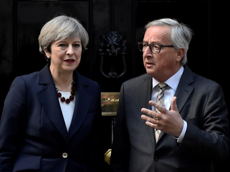 Theresa May welcomes Jean-Claude Juncker to Downing Street: Reuters