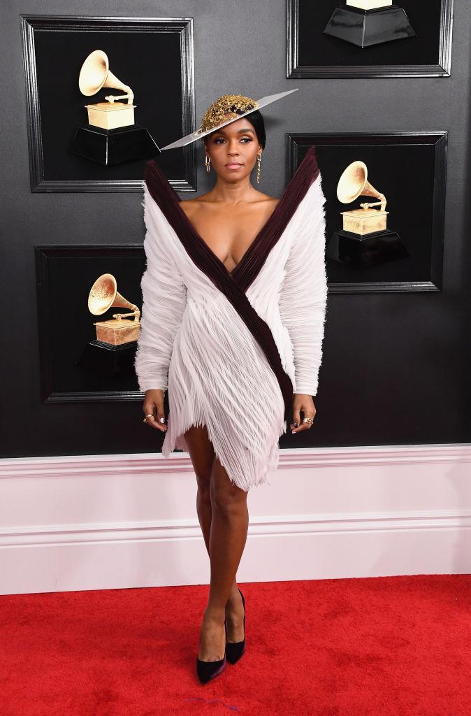 """<p>Nominee Janelle Monáe modeled a sophisticated dress that looked like a museum piece, along with a dramatic hat. Later, the songstress performed her song """"Make Me Feel."""" </p>"""