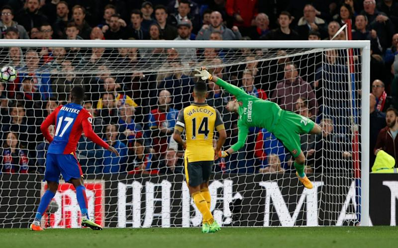 Crystal Palace's Yohan Cabaye (not in shot) scores their second goal as Arsenal's Emiliano Martinez attempts to save - Credit: Reuters