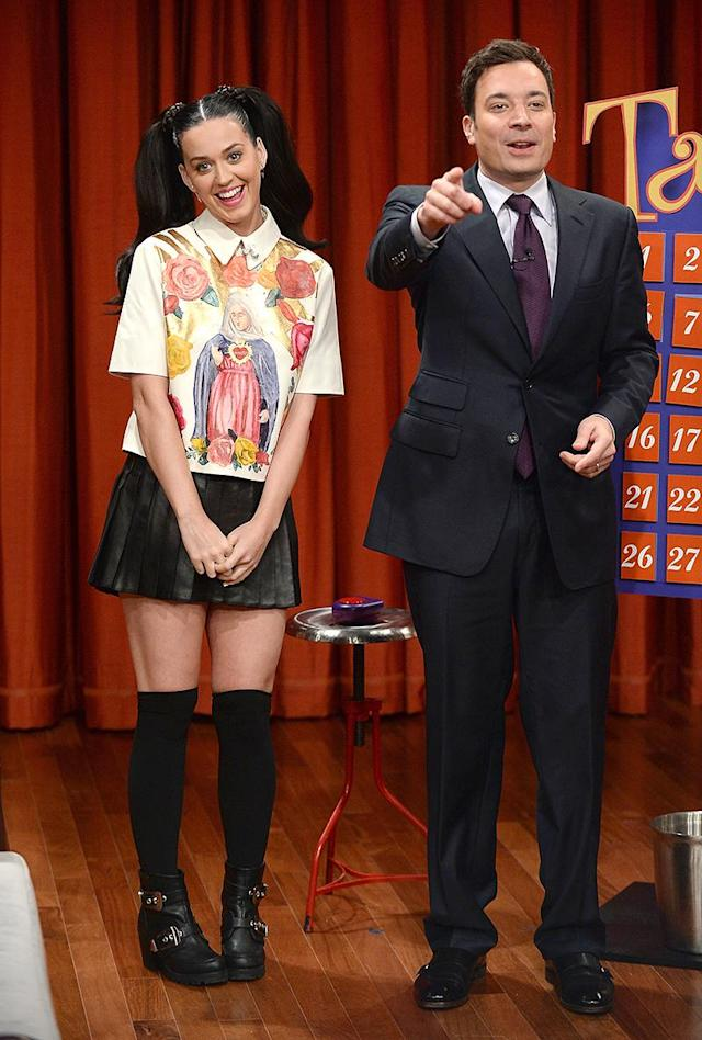 """<p>Perry was the picture of a Catholic schoolgirl during a 2013 stop at <em>The Tonight Show Starring Jimmy Fallon</em>. Her pigtails and religious top must have reminded her of growing up the daughter of traveling ministers in an ultra-religious household, where she called deviled eggs """"angel eggs"""" and attended Christian schools. (Photo: Theo Wargo/Getty Images) </p>"""