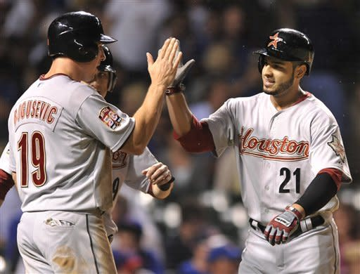 Houston Astros' Fernando Martinez right, celebrates with teammate Brian Bogusevic after hitting a three-run home run against the Chicago Cubs in the sixth inning during a baseball game in Chicago, Tuesday, Aug. 14, 2012. (AP Photo/Paul Beaty)