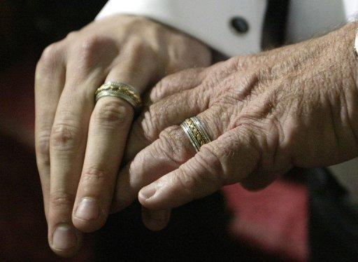 A male couple show their wedding rings to the media after a ceremony in Toronto, Canada. Currently, The Netherlands, Belgium, Canada, South Africa, Argentina, Spain, Portugal, Norway, Sweden, Denmark, Iceland and Uruguay allow same-sex marriage