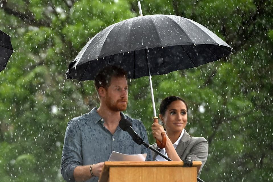 Later on in a heartfelt speech, Harry acknowledged the difficult times many farmers have gone through, but got rather drenched from an unexpected downpour. Source: AAP