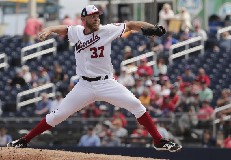 Washington Nationals starting pitcher Stephen Strasburg (37) delivers in the first inning during an exhibition spring training baseball game against the New York Mets on Thursday, March 7, 2019, in West Palm Beach. (AP Photo/Brynn Anderson)