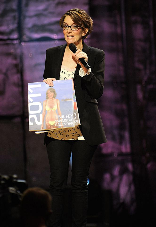 """Funny lady Tina Fey jokingly unveiled her new, not-so-sexy swimsuit calendar during Saturday's """"Night of Too Many Stars: An Overbooked Concert for Autism Education"""" at the Beacon Theatre in NYC. The event has raised almost $7 million for charity since it began airing on Comedy Central in 2005. Kevin Mazur/<a href=""""http://www.wireimage.com"""" target=""""new"""">WireImage.com</a> - October 2, 2010"""