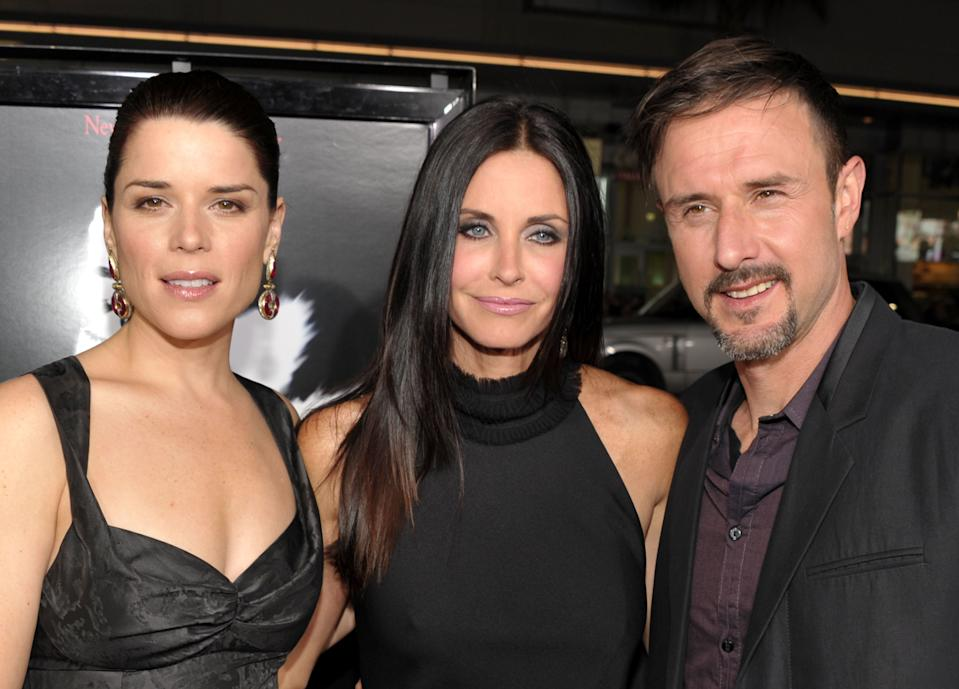 "(L-R) Actors Neve Campbell, Courteney Cox and David Arquette arrive at the world premiere of The Weinstein Company's ""Scre4m"" presented by AXE Shower at Grauman's Chinese Theatre on April 11, 2011 in Hollywood, California. (Photo by John Shearer/WireImage)"