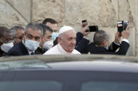 Pope Francis leaves the Sayidat al-Nejat (Our Lady of Salvation) Cathedral, in Baghdad, Iraq, Friday, March 5, 2021. Pope Francis has honored victims of one of Iraq's most brutal massacres of Christians by Islamic militants. He is making a visit to Baghdad's Our Lady of Salvation Cathedral, where he has prayed and spoke with priests, seminarians and religious sisters. In 2010, al-Qaida-linked militants gunned down worshippers at the church in an attack that left 58 people dead. (AP Photo/Andrew Medichini)