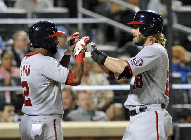 Washington Nationals' Jayson Werth, right, celebrates with Denard Span after Werth hit a three-run home run during the third inning of a baseball game against the New York Mets, Monday, Sept. 9, 2013, in New York. (AP Photo/Bill Kostroun)