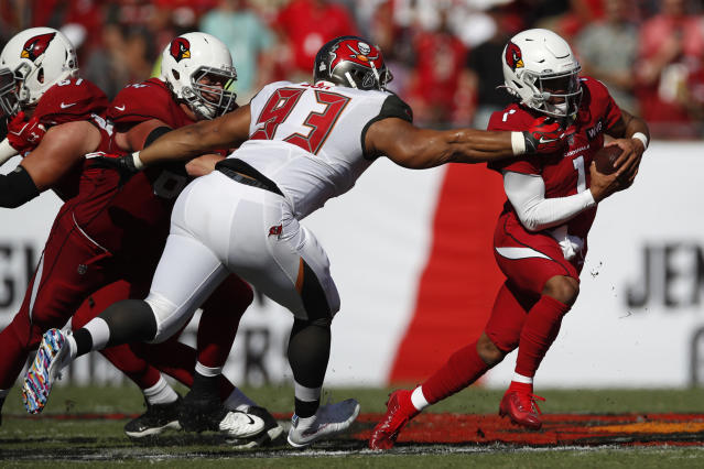 FILE - In this Nov. 10, 2019, file photo, Tampa Bay Buccaneers nose tackle Ndamukong Suh (93) brings down Arizona Cardinals quarterback Kyler Murray (1) during an NFL football game in Tampa, Fla. The Buccaneers announced Thursday, March 26, 2020, that the team had re-signed defensive lineman Ndamukong Suh.(AP Photo/Jeff Haynes, File)