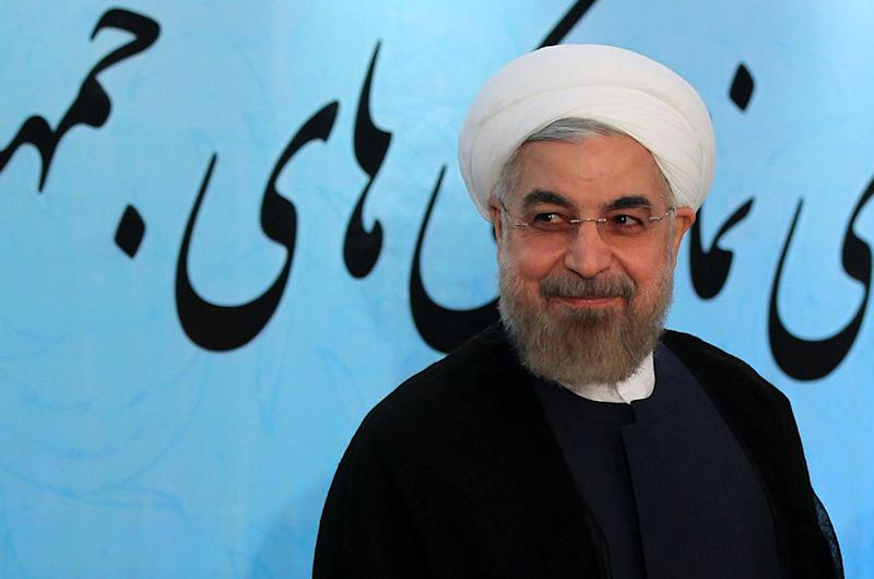 A picture released by the official website of the Iranian President Hassan Rouhani shows him smiling as he speaks during a meeting with Iranian foreign ambassadors and diplomats visiting the Iranian capital on August 11, 2014 in Tehran (AFP Photo/Mohammad Berno)