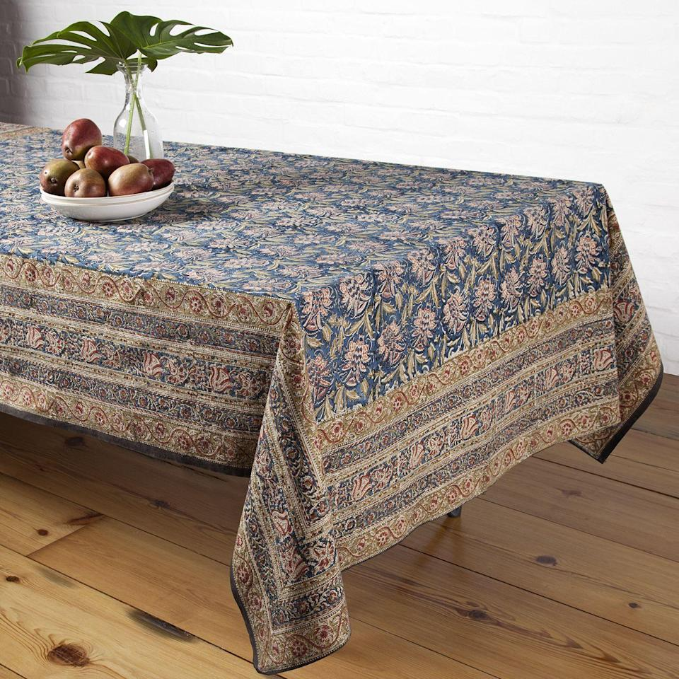 "<p>marigoldliving.com</p><p><strong>$105.00</strong></p><p><a href=""https://marigoldliving.com/pineapple-tablecloth-teal.html"" rel=""nofollow noopener"" target=""_blank"" data-ylk=""slk:Shop Now"" class=""link rapid-noclick-resp"">Shop Now</a></p><p>Earthy tones are the perfect color palette to base your Thanksgiving table design around. Think beyond browns and beiges with this kalamkari cotton tablecloth that offers dramatic elegance.<br></p>"