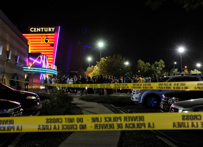 People gather outside the Century 16 movie theater in Aurora, Colo., at the scene of a mass shooting early Friday morning, July 20, 2012.