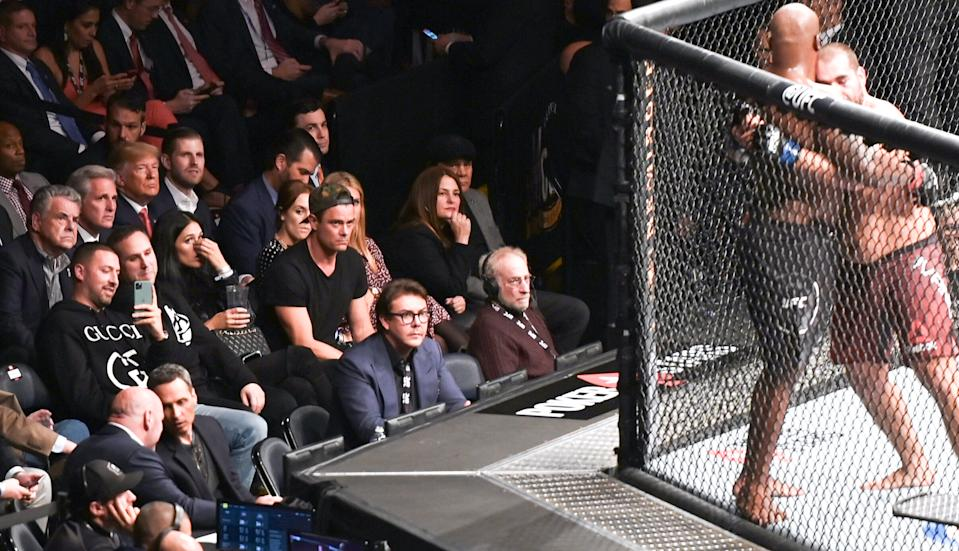US President Donald Trump (3rd row 3L), his son Eric Trump (3rd row 4L) and House Minority Leader Kevin McCarthy (3rd row 2L) watch the Ultimate Fighting Championship at Madison Square Garden in New York City, New York on November 2, 2019. (Photo by Andrew Caballero-reynolds / AFP) / The erroneous mention[s] appearing in the metadata of this photo by Andrew Caballero-reynolds has been modified in AFP systems in the following manner: [House Minority Leader Kevin McCarthy] instead of [Republican US representative for North Carolina Mark Meadows]. Please immediately remove the erroneous mention[s] from all your online services and delete it (them) from your servers. If you have been authorized by AFP to distribute it (them) to third parties, please ensure that the same actions are carried out by them. Failure to promptly comply with these instructions will entail liability on your part for any continued or post notification usage. Therefore we thank you very much for all your attention and prompt action. We are sorry for the inconvenience this notification may cause and remain at your disposal for any further information you may require. (Photo by ANDREW CABALLERO-REYNOLDS/AFP via Getty Images)
