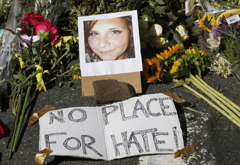 A makeshift memorial of flowers and a photo of victim Heather Heyer in Charlottesville, Va., on Aug. 13, 2017. Heyer was killed when a car rammed into a group of people protesting the presence of white supremacists who had gathered in the city for a rally. (Photo: Steve Helber/AP)