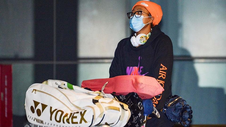 Naomi Osaka, pictured here arriving in Adelaide before heading to hotel quarantine.