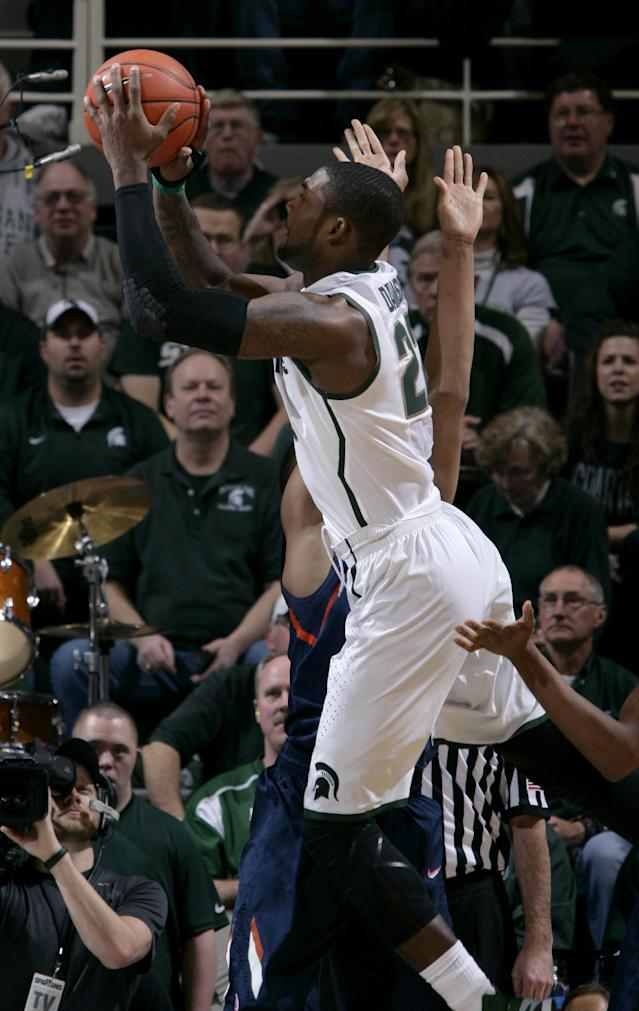 Michigan State's Branden Dawson (22) shoots against Illinois' Malcolm Hill, rear, to score Michigan State's first points during the first half of an NCAA college basketball game, Saturday, March 1, 2014, in East Lansing, Mich. (AP Photo/Al Goldis)