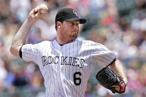 Colorado Rockies starting pitcher Alex White (6) challenges Los Angeles Dodgers' Dee Gordon during the first inning of a baseball game on Sunday, June 3, 2012 in Denver, Colo. (AP Photo/Barry Gutierrez)