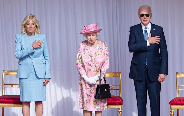 WINDSOR, ENGLAND - JUNE 13: Queen Elizabeth II (C), US President Joe Biden (R) and US First Lady Dr Jill Biden (L) at Windsor Castle on June 13, 2021 in Windsor, England. Queen Elizabeth II hosts US President, Joe Biden and First Lady Dr Jill Biden at Windsor Castle. The President arrived from Cornwall where he attended the G7 Leader's Summit and will travel on to Brussels for a meeting of NATO Allies and later in the week he will meet President of Russia, Vladimir Putin.  (Photo by Samir Hussein - Pool/WireImage )