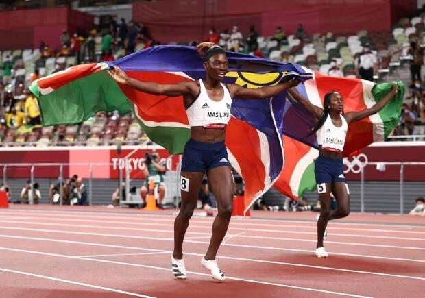 Namibia's Beatrice Masilingi, left, celebrates with teammate and silver-medal winner Christine Mboma after the women's 200m final at the Tokyo Olympics in Japan on Tuesday. (Ryan Pierse/Getty Images - image credit)